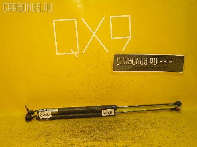 Амортизатор двери SUBARU LEGACY WAGON BG5. Фото 2