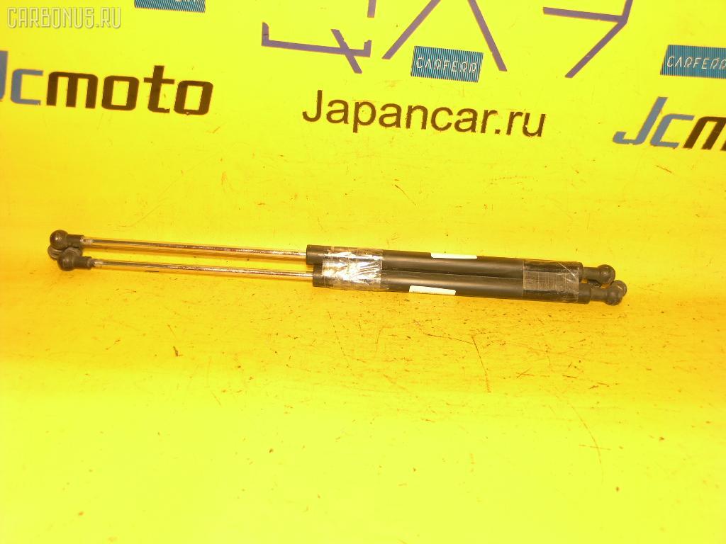 Амортизатор капота TOYOTA CRESTA GX100. Фото 8