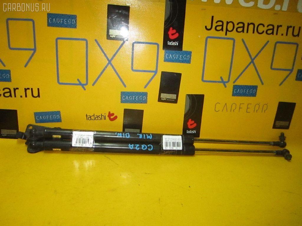 Амортизатор двери MITSUBISHI DINGO CQ2A Фото 1