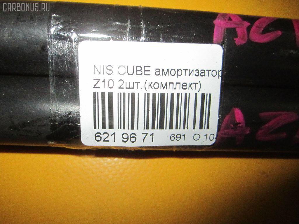Амортизатор двери NISSAN CUBE Z10 Фото 2