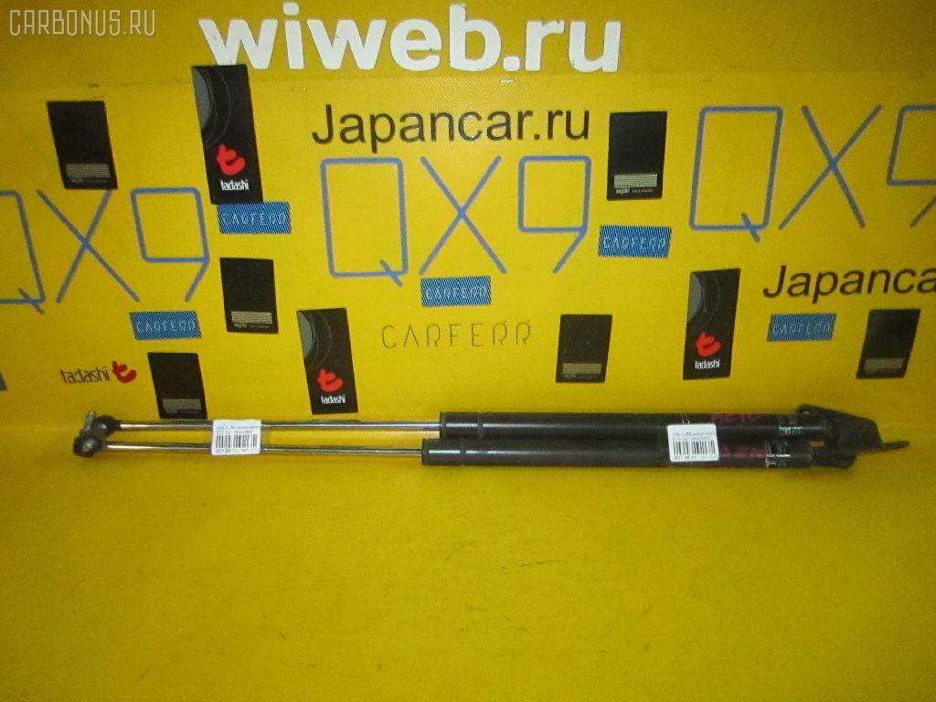 Амортизатор двери NISSAN CUBE Z10 Фото 1