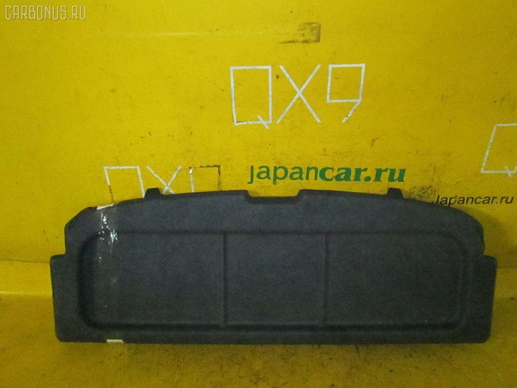 Шторка багажника TOYOTA DUET M100A. Фото 2