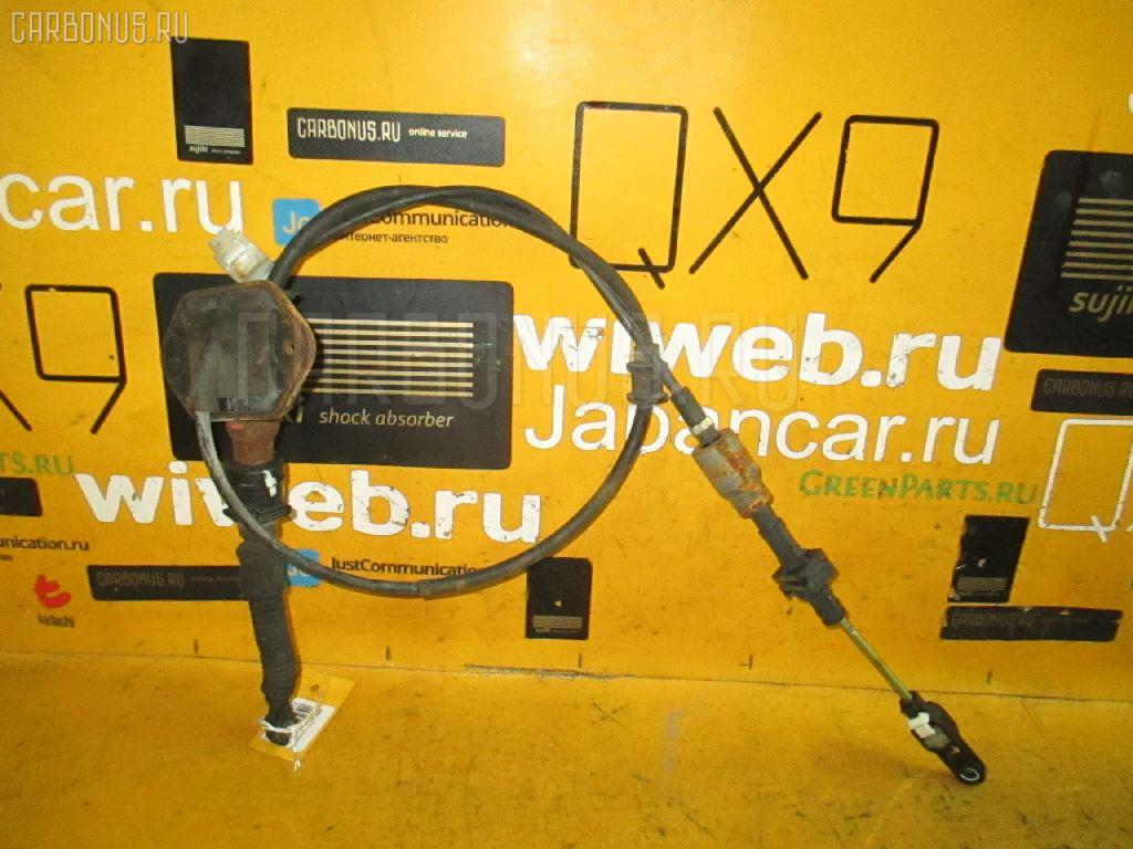Тросик на коробку передач MAZDA DEMIO DY5W ZY-VE. Фото 2