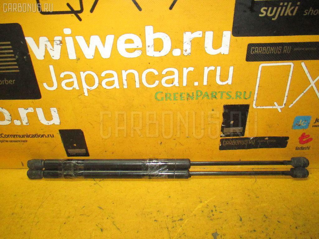Амортизатор двери NISSAN WINGROAD WFY11. Фото 9