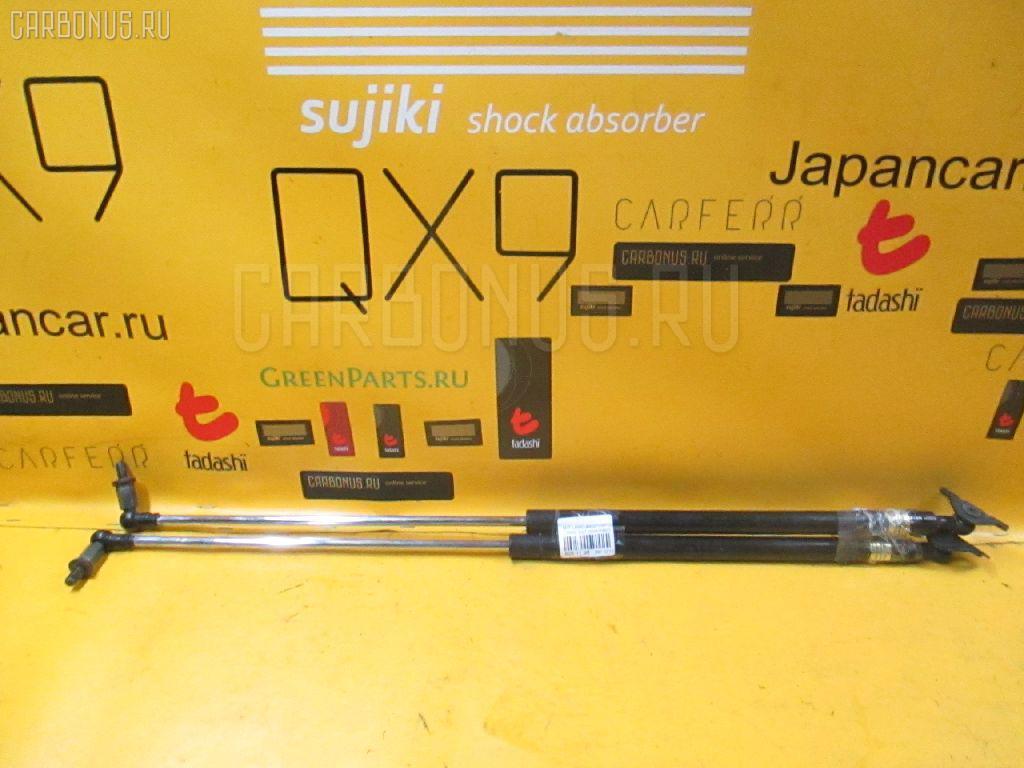 Амортизатор двери Mitsubishi Lancer cedia wagon CS5W Фото 1