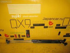 Амортизатор двери Nissan Cube AZ10 Фото 1