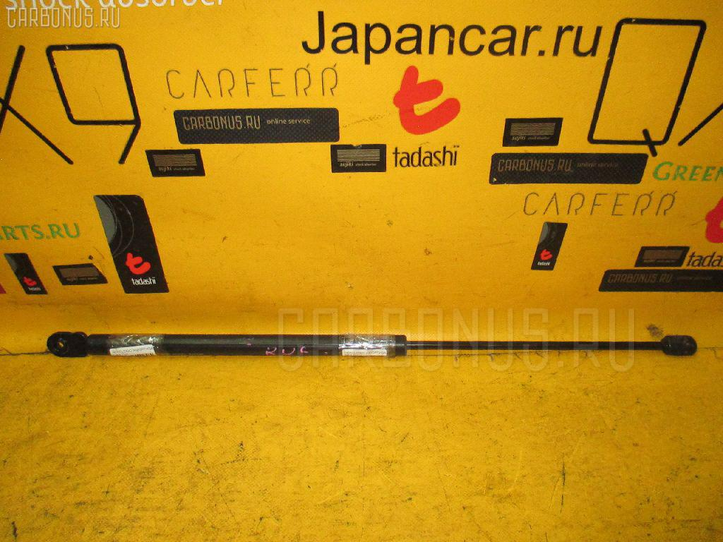Амортизатор двери HONDA LOGO GA3. Фото 2