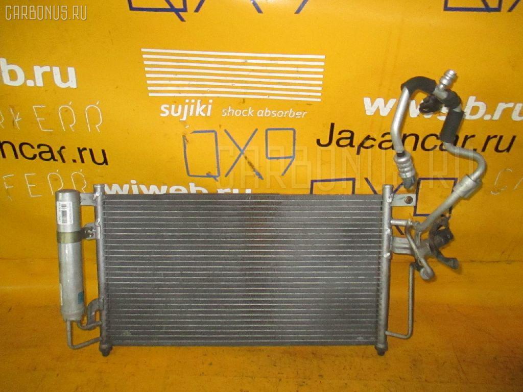 Радиатор кондиционера MAZDA DEMIO DY3W. Фото 9