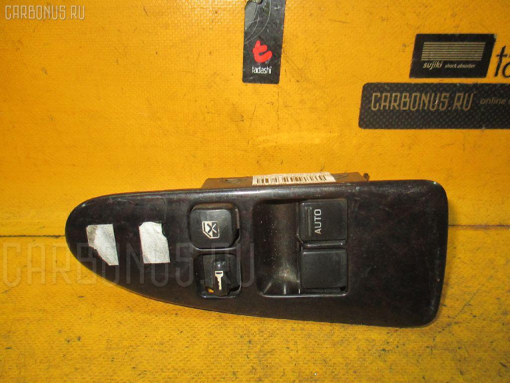 Блок упр-я стеклоподъемниками NISSAN LARGO W30 Фото 1