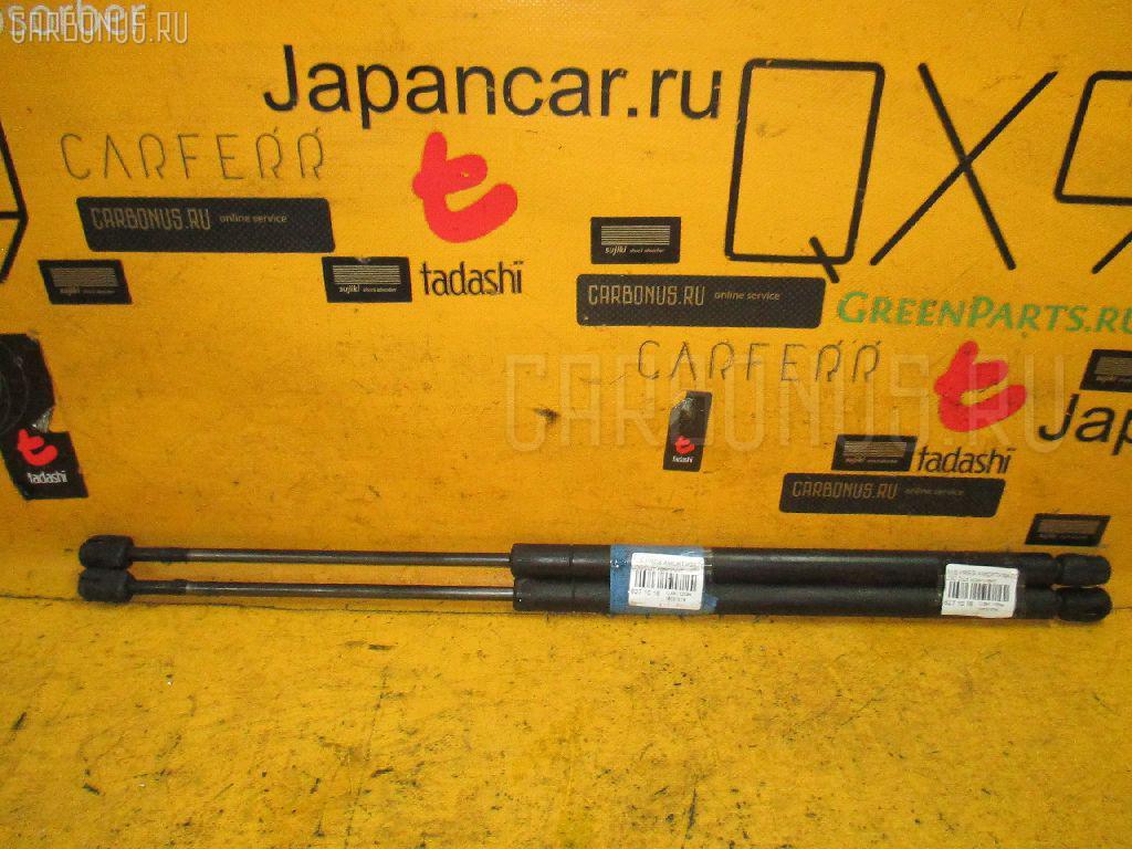 Амортизатор двери NISSAN PRESAGE U30 Фото 1