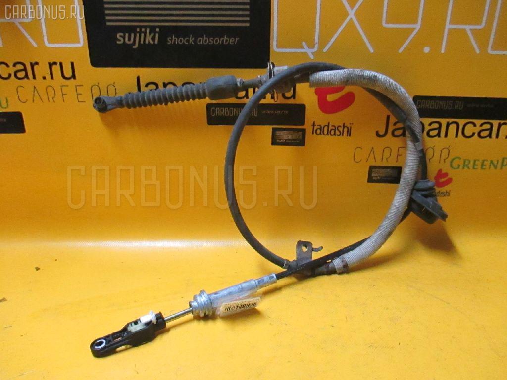Тросик на коробку передач MAZDA DEMIO DW3W B3. Фото 5