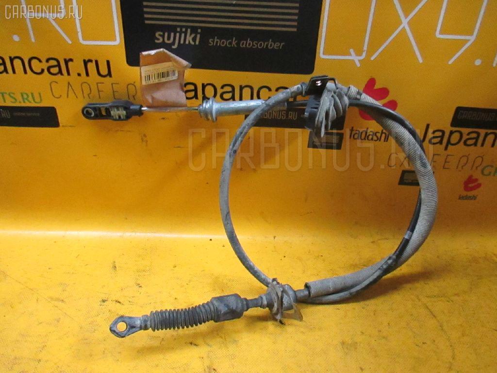 Тросик на коробку передач MAZDA DEMIO DW3W B3. Фото 9
