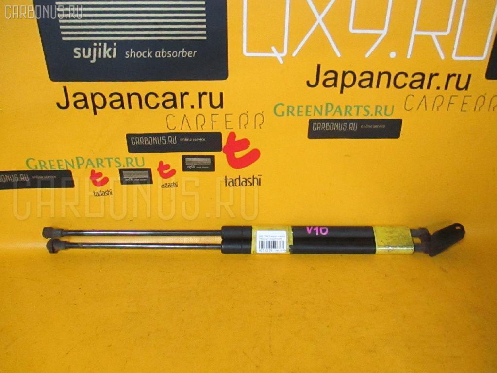 Амортизатор двери NISSAN TINO V10. Фото 7