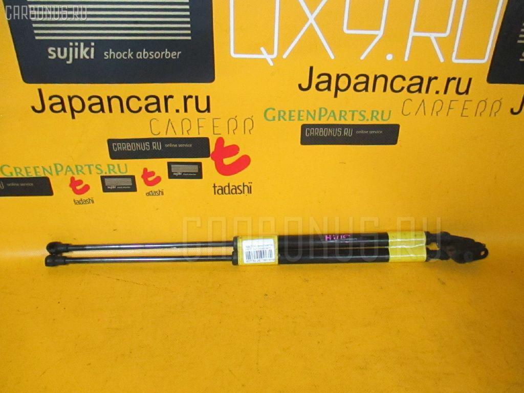 Амортизатор двери NISSAN TINO HV10. Фото 5