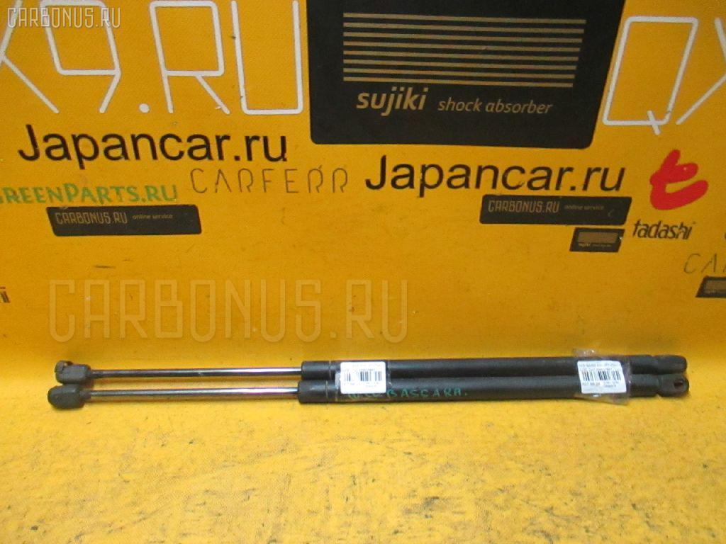 Амортизатор двери NISSAN BASSARA JU30. Фото 8