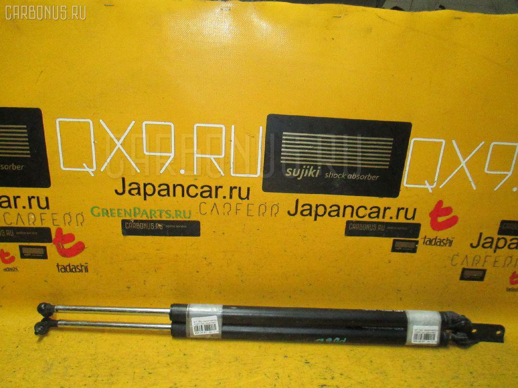 Амортизатор двери MITSUBISHI DELICA SPACE GEAR PD6W Фото 1