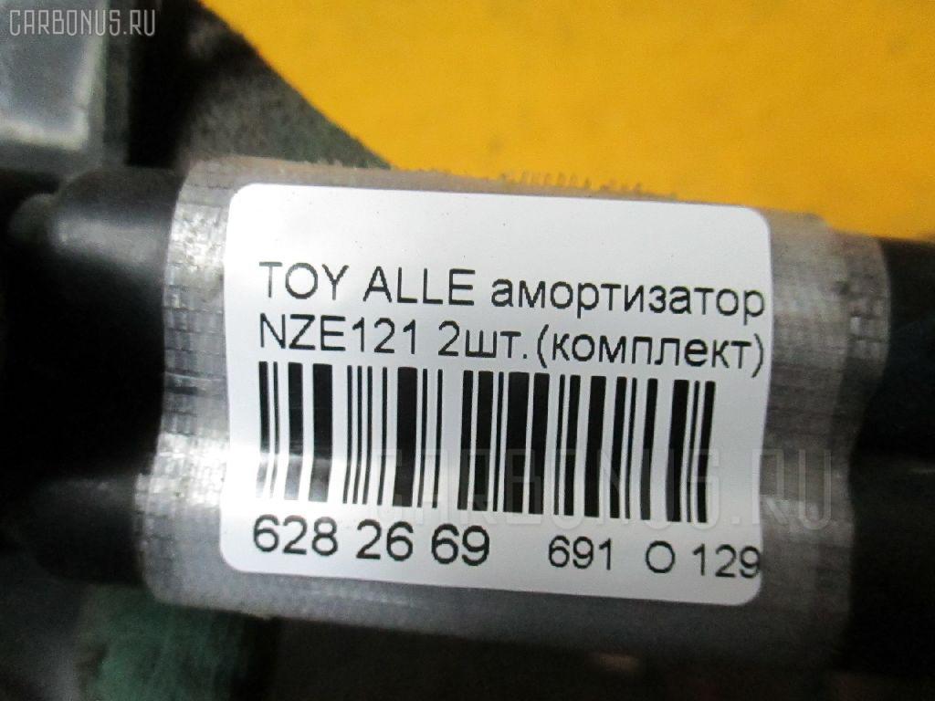 Амортизатор двери TOYOTA ALLEX NZE121 Фото 2