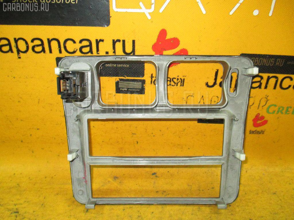 Консоль магнитофона на Mitsubishi Pajero Io H76W Фото 1