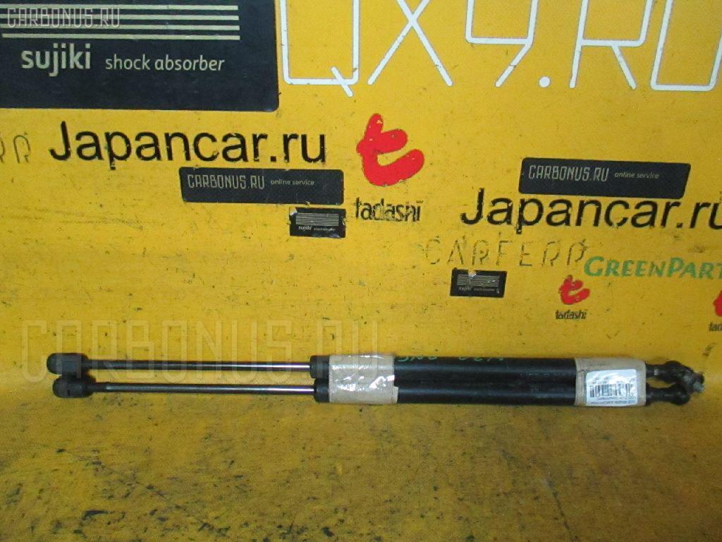 Амортизатор двери NISSAN RNESSA N30 Фото 1