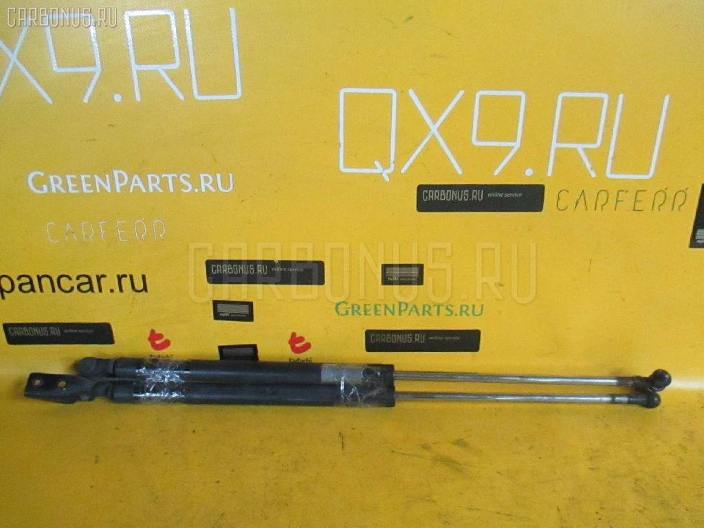 Амортизатор двери MAZDA FAMILIA S-WAGON BJFW Фото 1