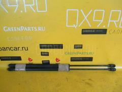 Амортизатор двери NISSAN PRESAGE HU30 Фото 1