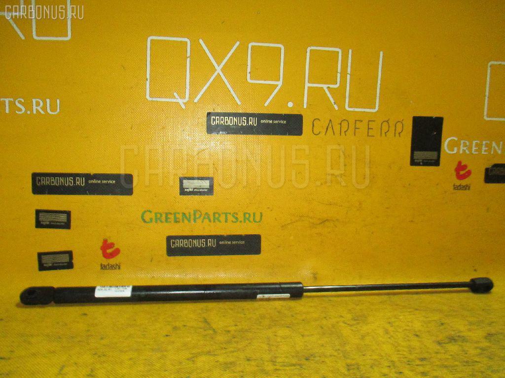 Амортизатор двери HONDA LOGO GA3. Фото 4