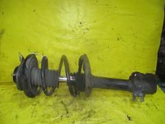 Стойка амортизатора на Nissan X-Trail T30 QR20DE 54303-8H700, Переднее Левое расположение
