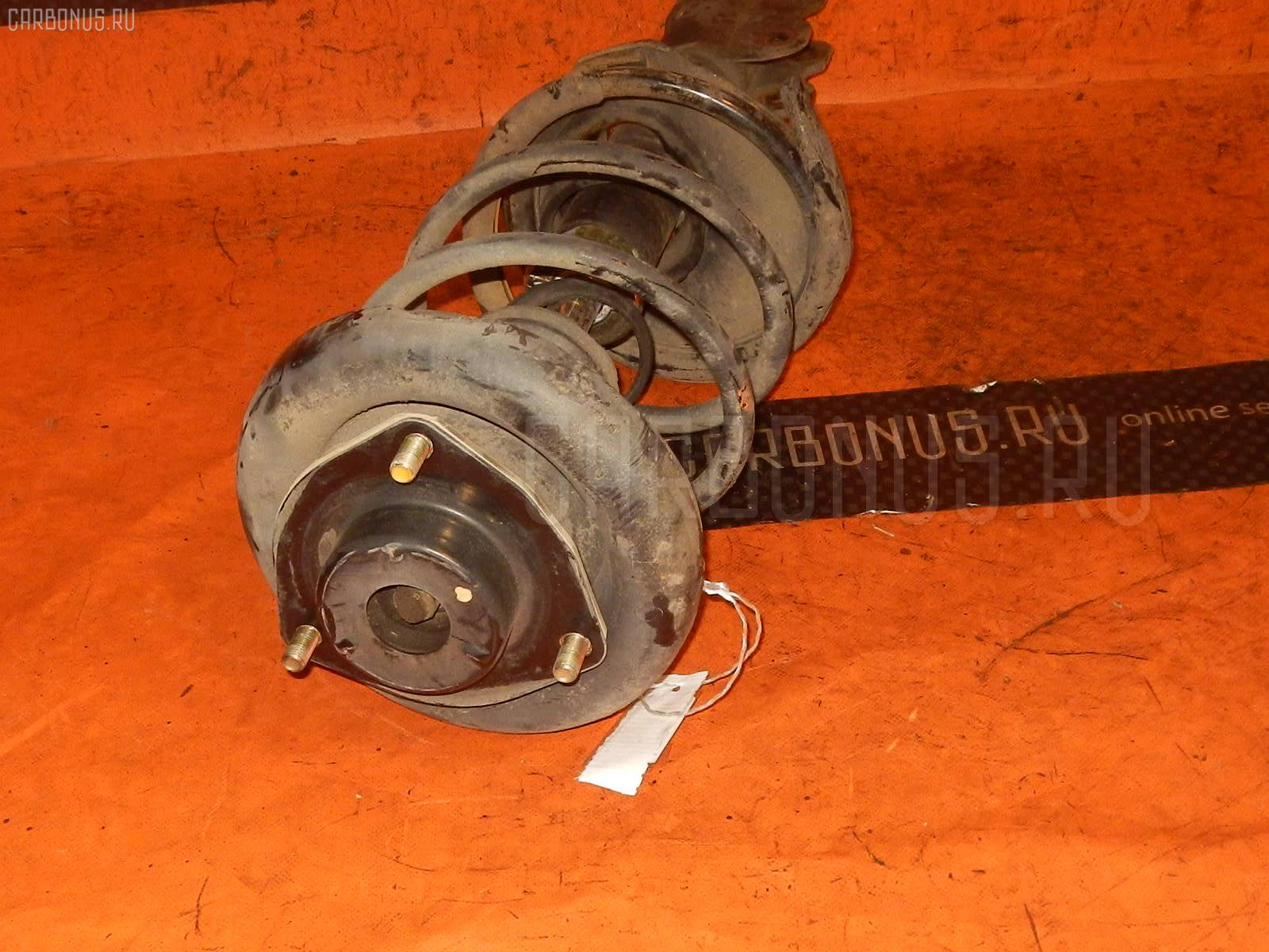 Стойка амортизатора Nissan Rnessa N30 SR20DE Фото 1