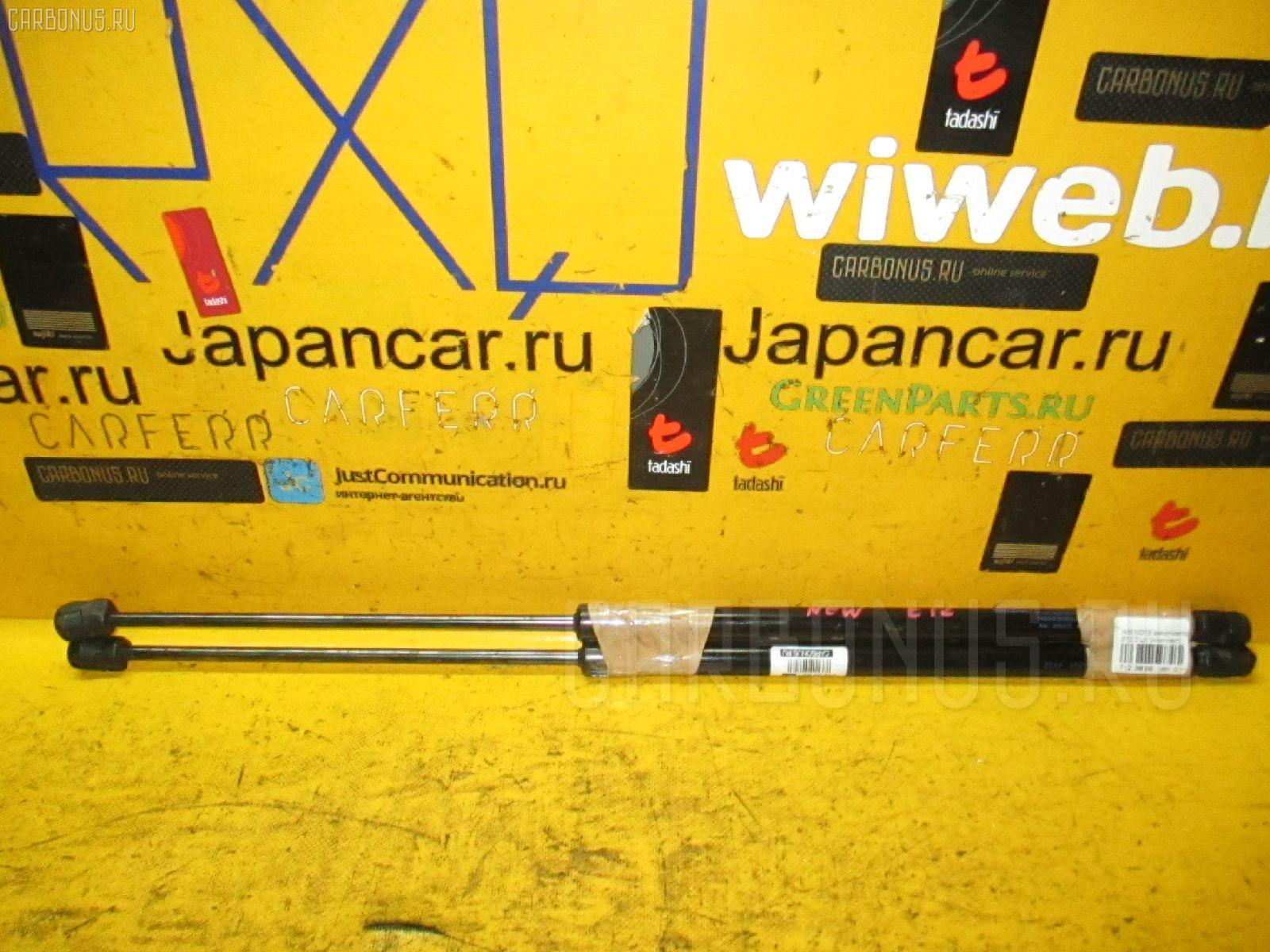 Амортизатор двери NISSAN NOTE E12 Фото 1