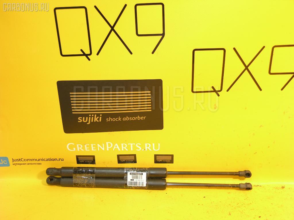 Амортизатор двери VOLKSWAGEN GOLF V 1KBLX Фото 1