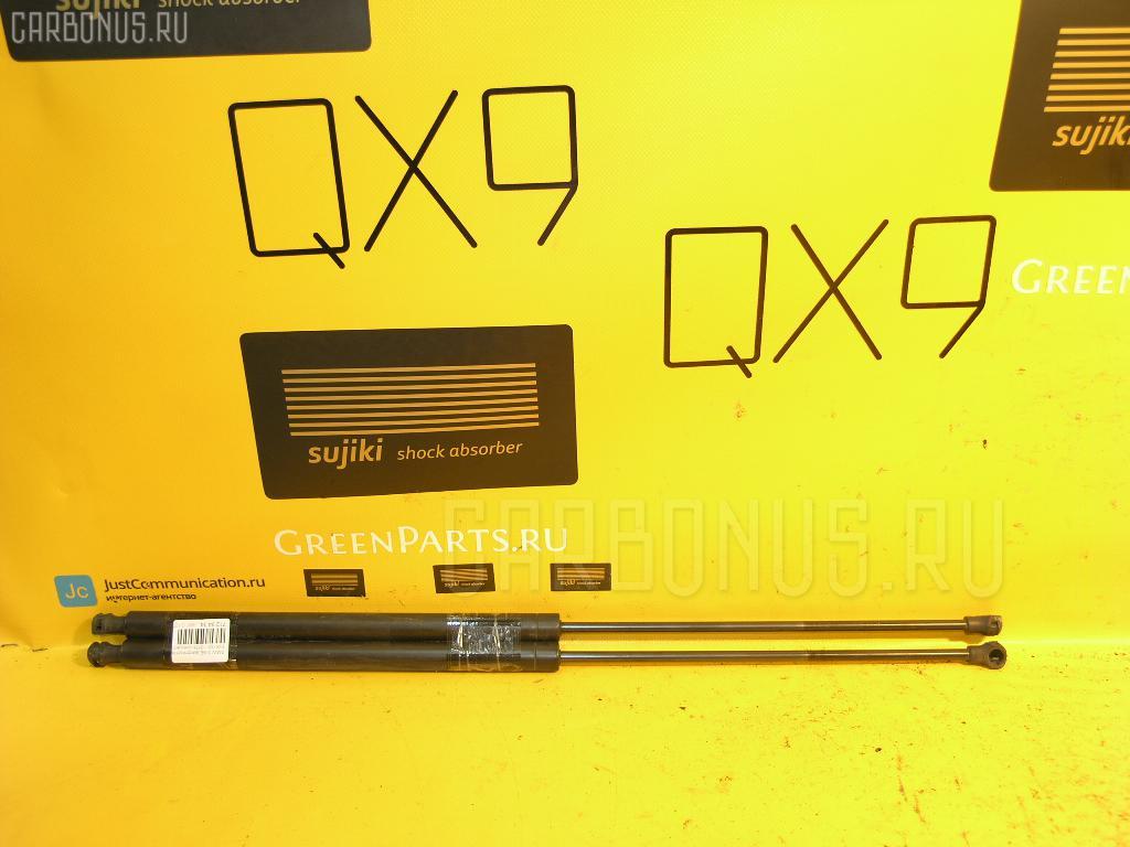 Амортизатор двери Bmw 3-series E46-AT52 Фото 1