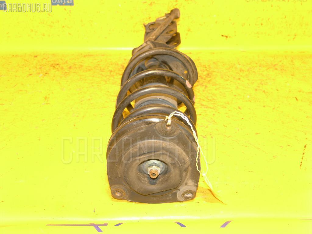 Стойка амортизатора NISSAN CUBE BZ11 CR14DE Фото 1