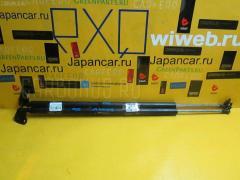 Амортизатор двери SUZUKI EVERY DA64V Фото 1