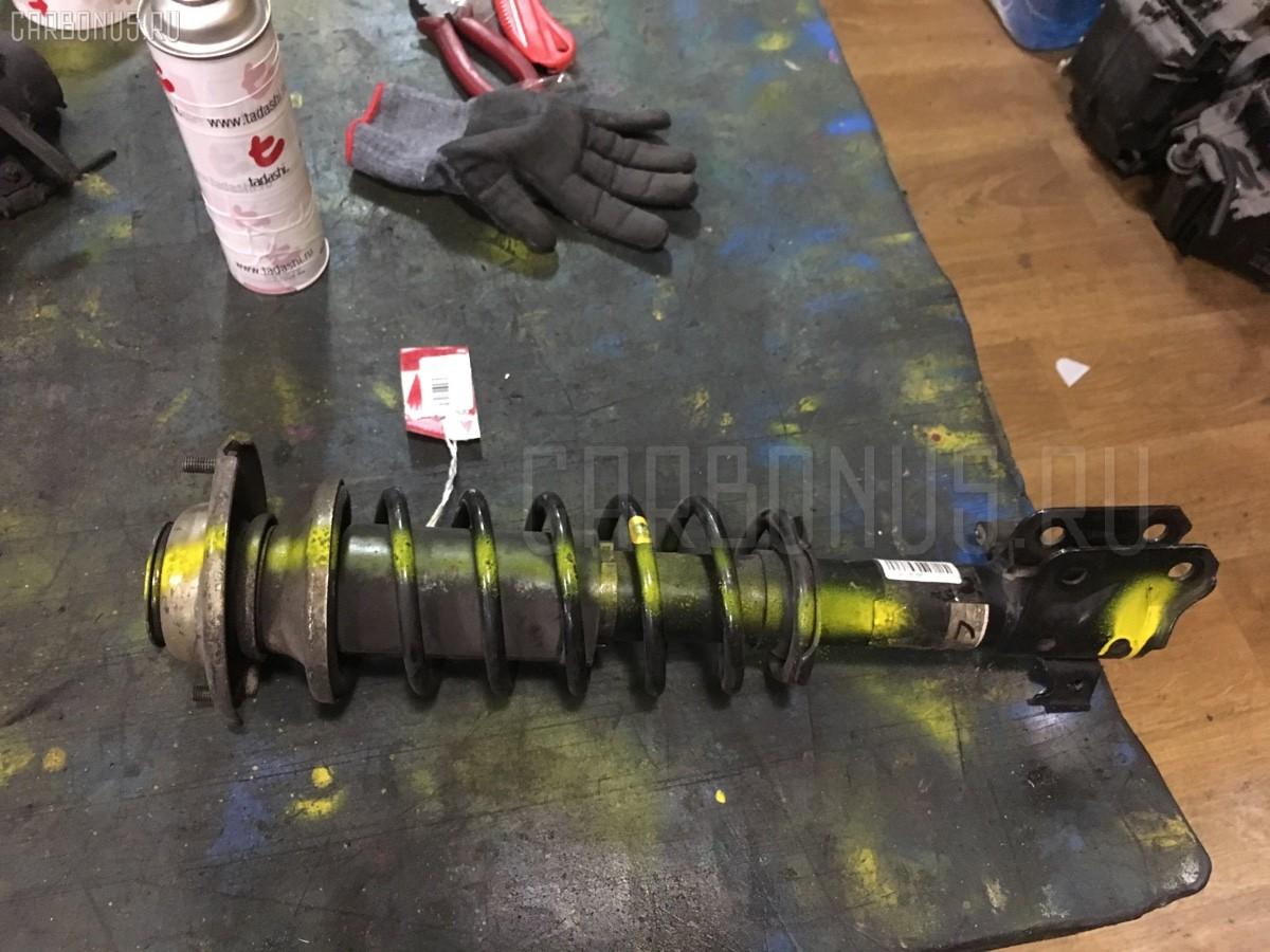 Стойка амортизатора Suzuki Alto HA23V K6A Фото 1
