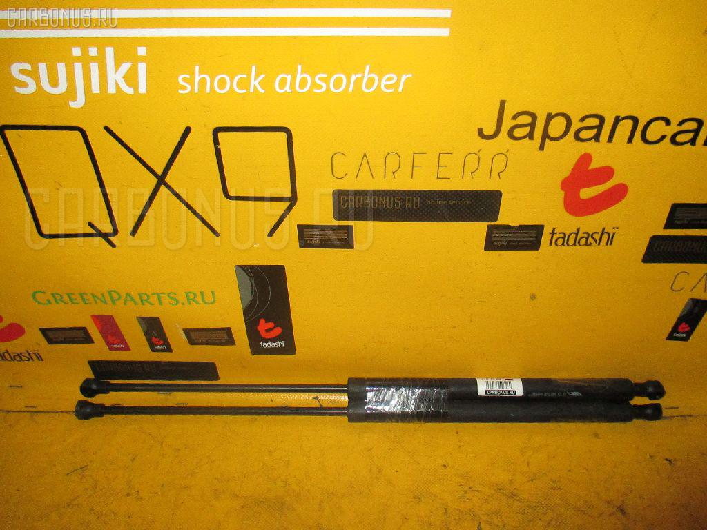 Амортизатор двери Peugeot 206 2AKFW Фото 1