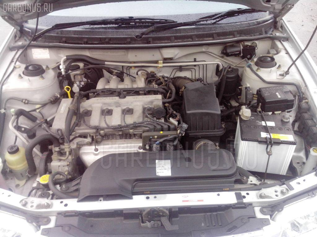 Тросик топливного бака MAZDA CAPELLA GF8P Фото 3