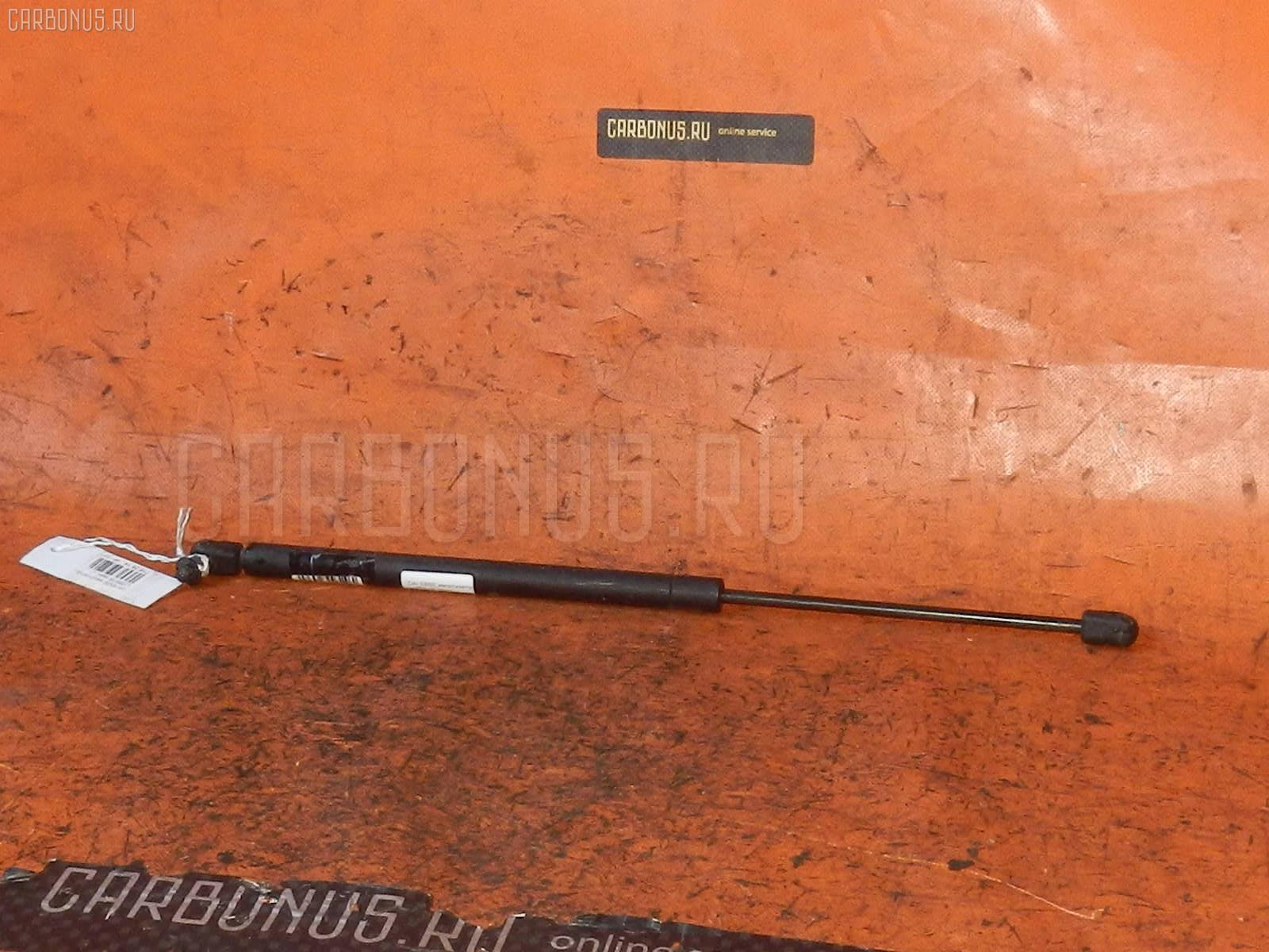 Амортизатор двери DAIHATSU ESSE L235S Фото 1