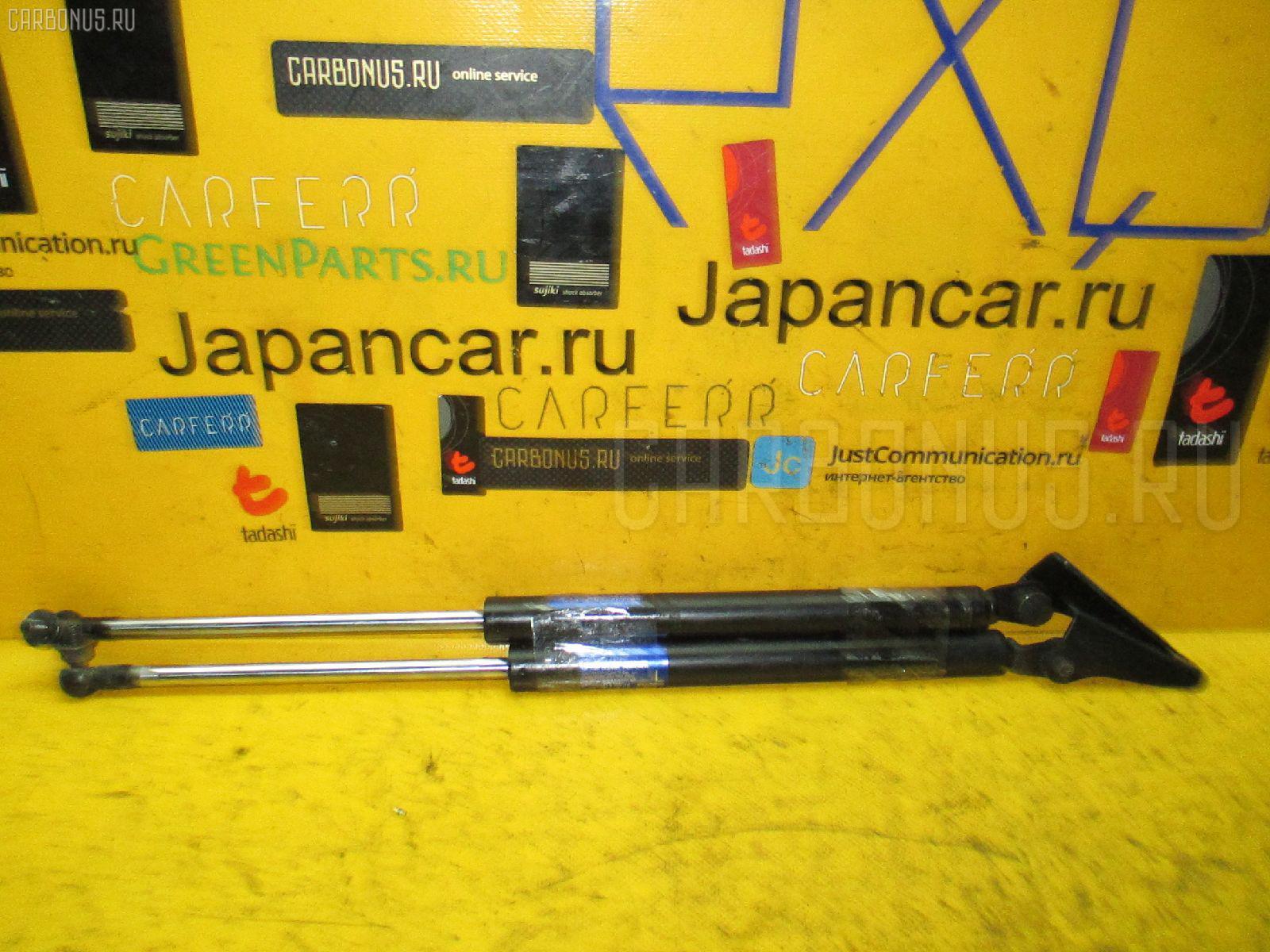 Амортизатор двери Subaru Dex M401F Фото 1