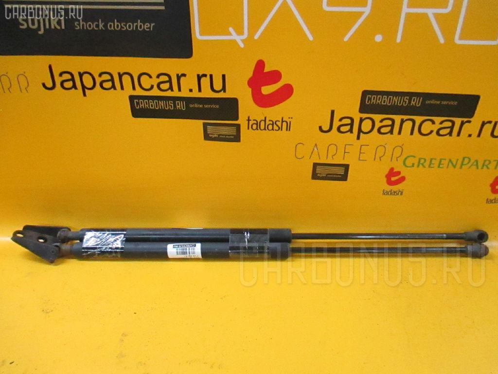 Амортизатор двери NISSAN TINO HV10. Фото 6