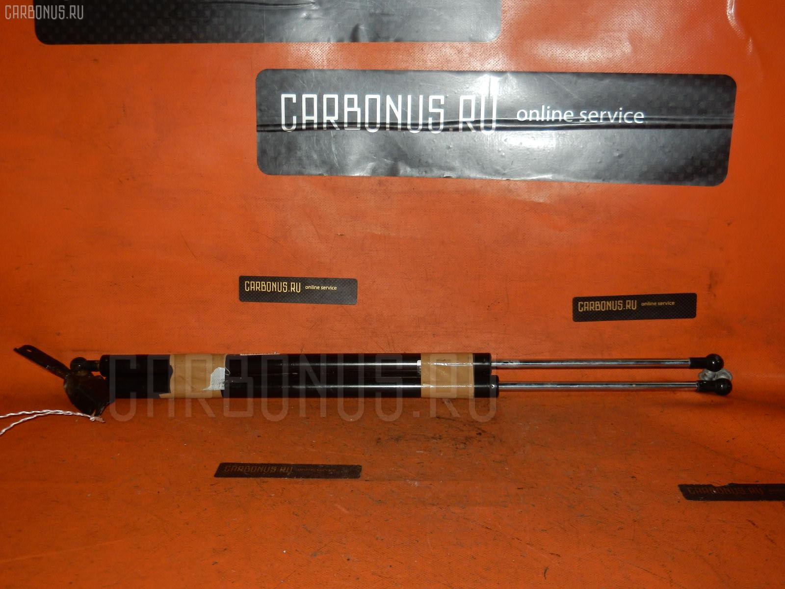 Амортизатор двери NISSAN WINGROAD Y12 Фото 1
