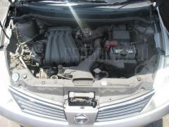 Тросик капота Nissan Tiida latio SC11 Фото 7