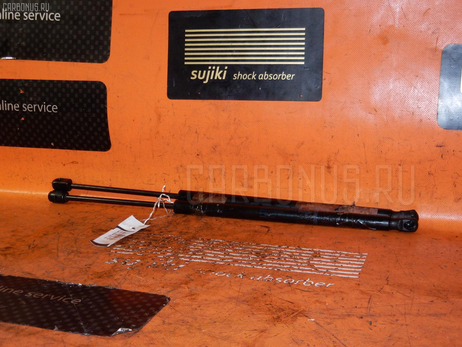 Амортизатор двери TOYOTA ISIS ANM15G Фото 1