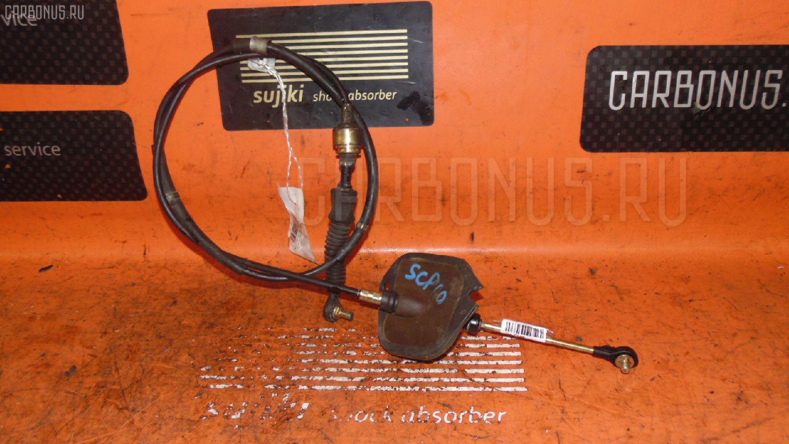 Тросик на коробку передач TOYOTA VITZ SCP10 1SZ-FE. Фото 6