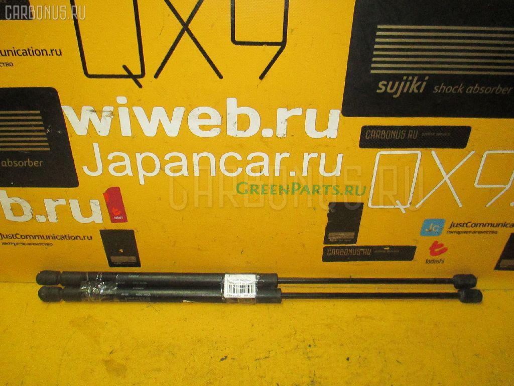 Амортизатор двери Mitsubishi Diamante wagon F36W Фото 1