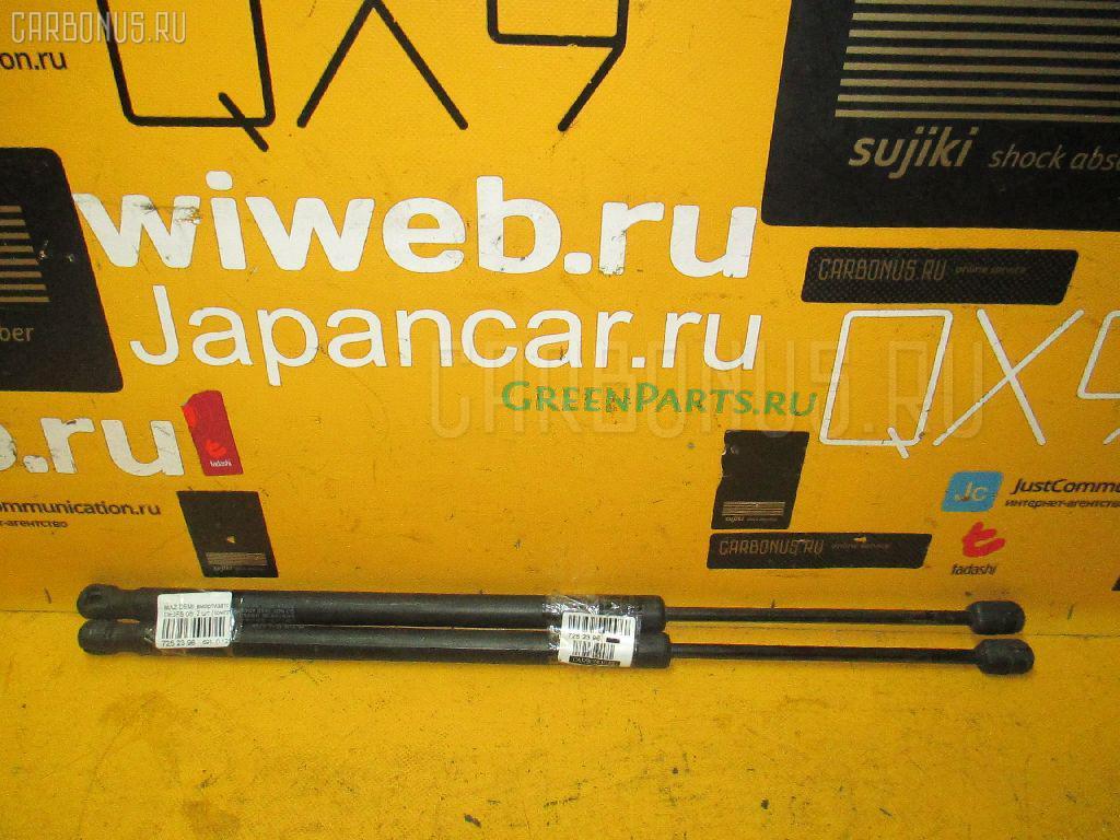 Амортизатор двери MAZDA DEMIO DE3FS Фото 1
