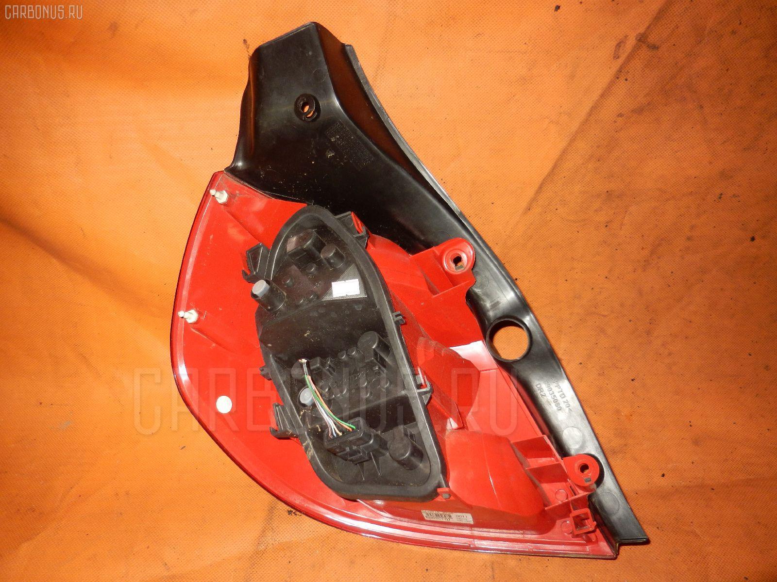 Стоп 04057 VF1CRJN00A0656659 на Renault Lutecia CRJN Фото 1