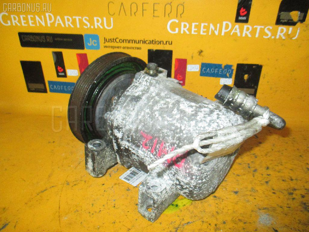 Компрессор кондиционера 92600-WF100 на Nissan Liberty PM12 SR20DE Фото 1