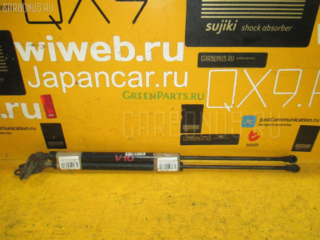 Амортизатор двери NISSAN TINO V10. Фото 11