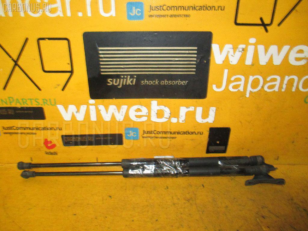 Амортизатор двери TOYOTA ALLEX ZZE123 Фото 1