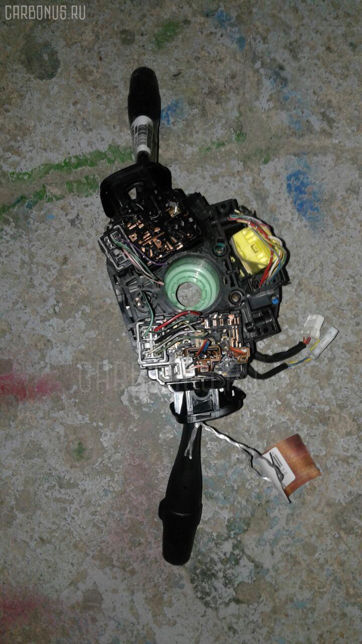 Переключатель поворотов NISSAN CEDRIC HY34 Фото 1